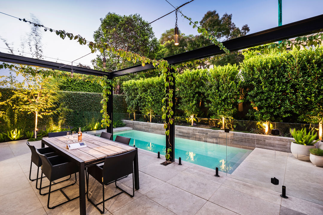 Esjay Landscapes + Pools courtyard pool with trellis and greenery